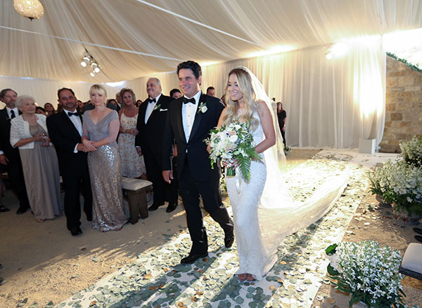 Lauren Conrad's dad walking her down the aisle.