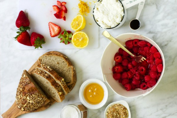 Fresh ingredients for smashed berry + ricotta toast.