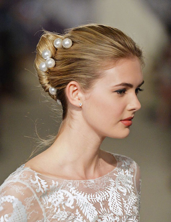 A chic French twist adorned in pearls.