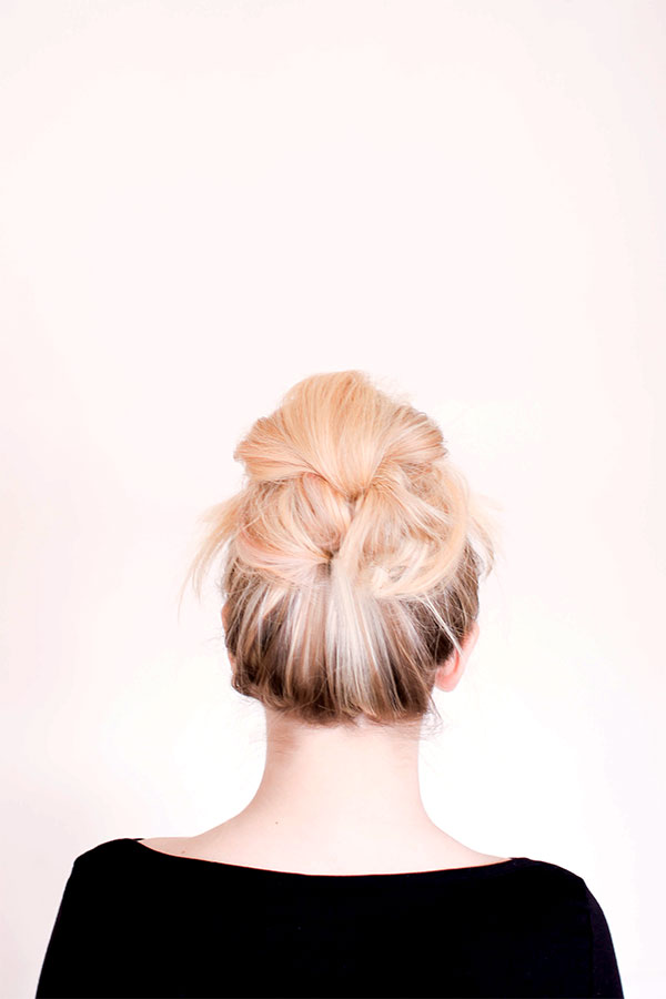 A messy bun with a twist! {via Sitting In Our Tree}