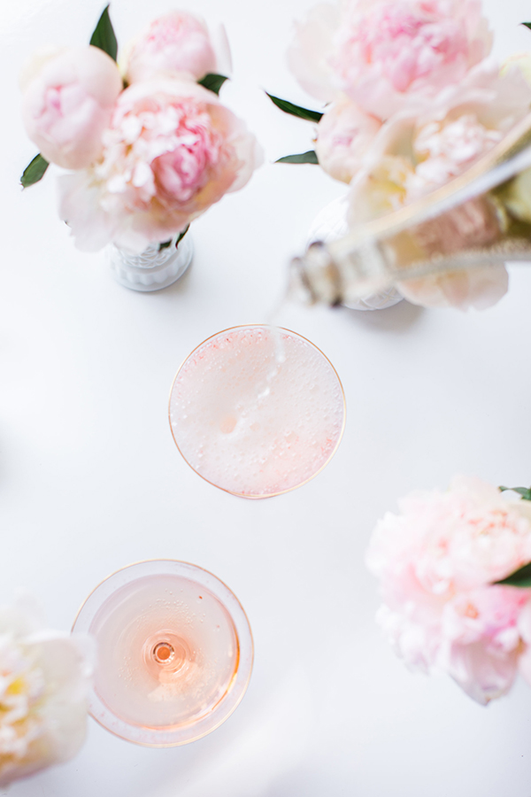 Pouring champagne over these Cotton Candy cocktails.