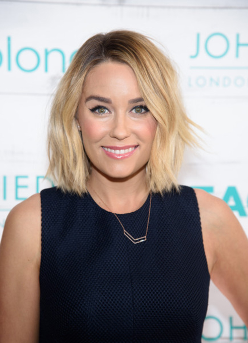 Lauren Conrad's signature winged eyeliner, pink cheeks, and beachy hair