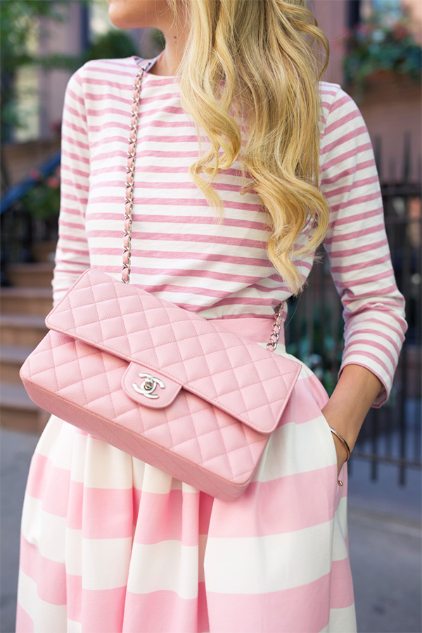 A gorgeous pink Chanel bag on our favorite fashion blogger, Blair Eadie.