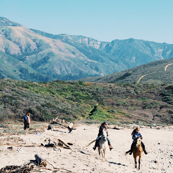 Horse riders on Big Sur River Mouth Beach.