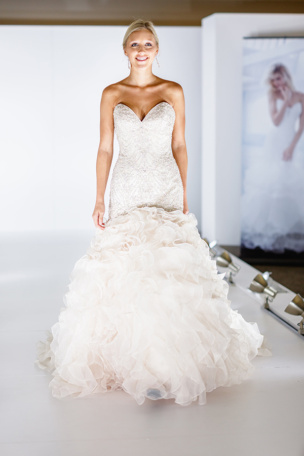 A fitted, intricate bustier and a ruffled skirt makes this wedding dress perfection!