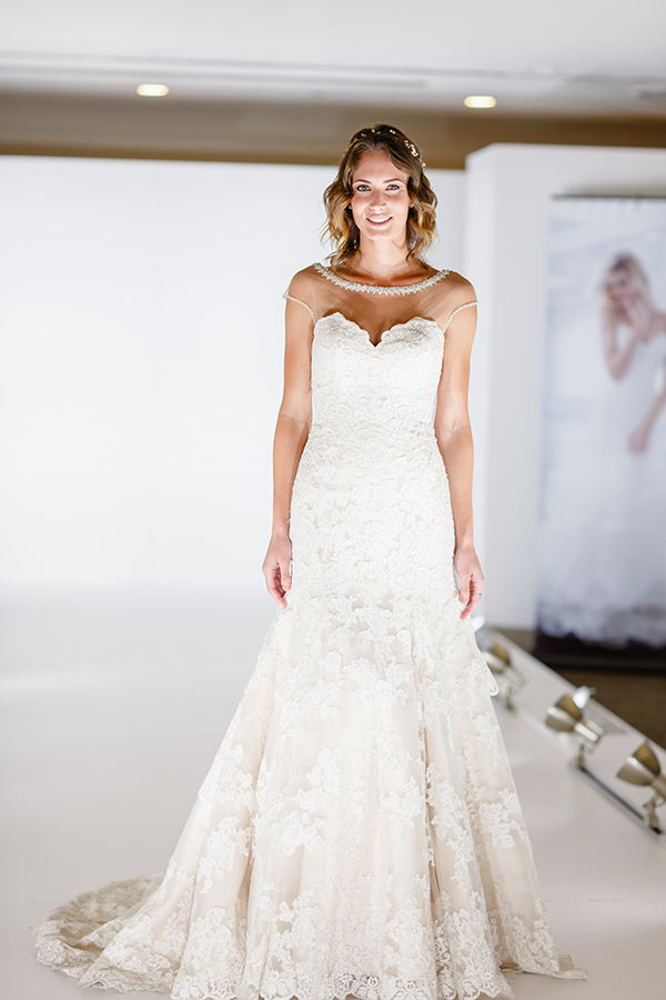 Designers at Allure will take a modern, sleek dress and add a vintage twist with details like lace or beading