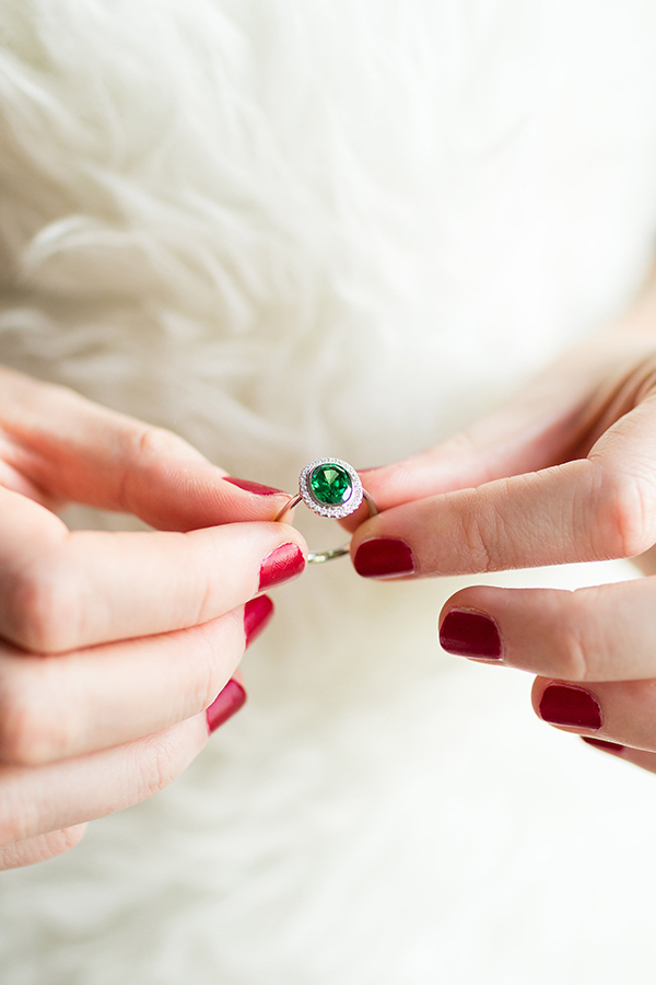 James Allen emerald engagement ring with diamond halo.
