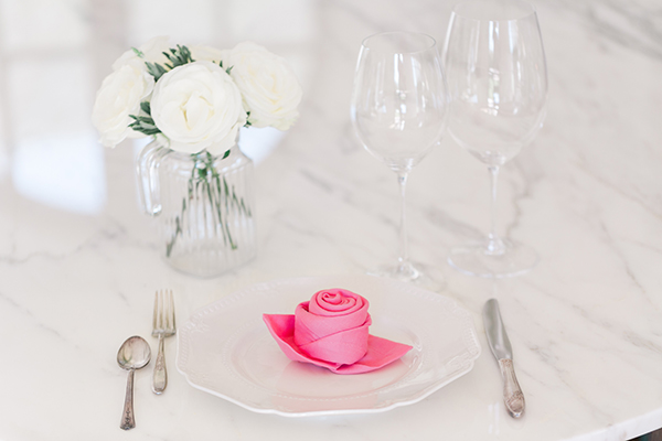 A sweet rose folded napkin tutorial by LaurenConrad.com.