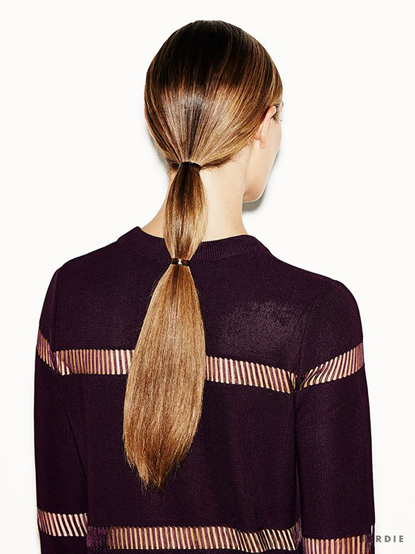 A sleep double ponytail via Byrdie.