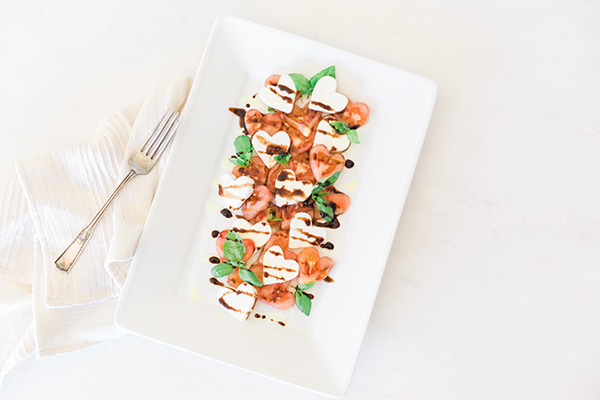 A heart-shaped caprese salad inspired by Valentine's Day.
