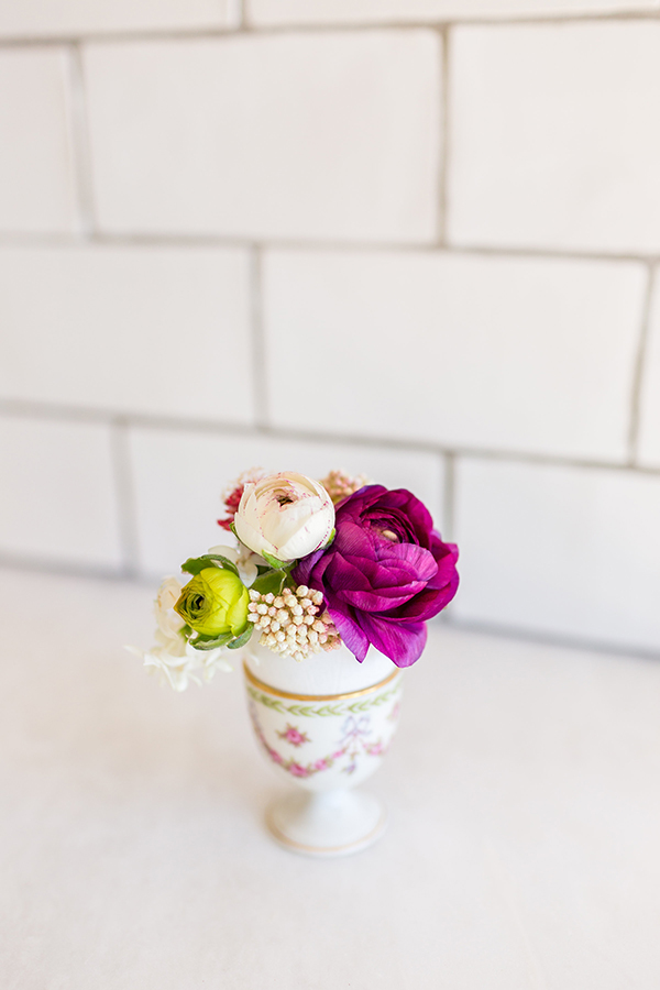 Mini flower arrangements in eggshell vases