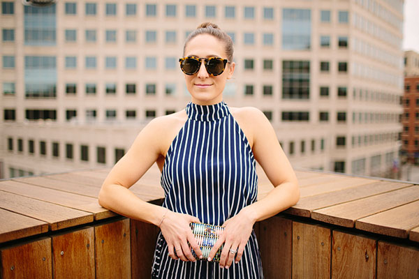 Tortoiseshell sunnies and a striped jumpsuit