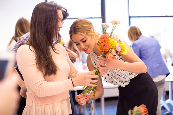 Creating flower arrangements at the Celebrate launch party