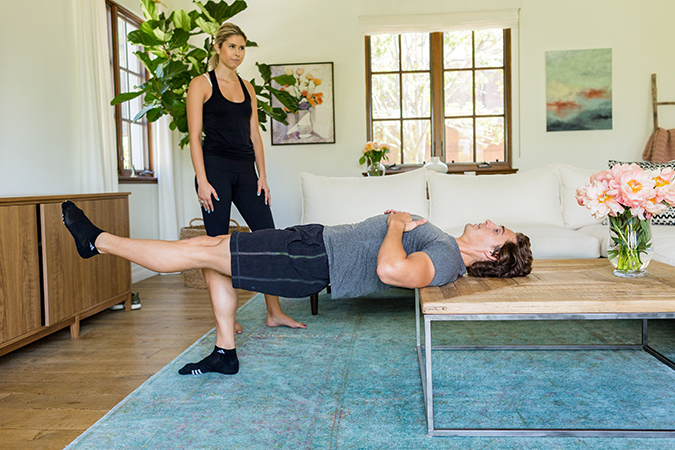 Tone that booty with these coffee table glute bridges
