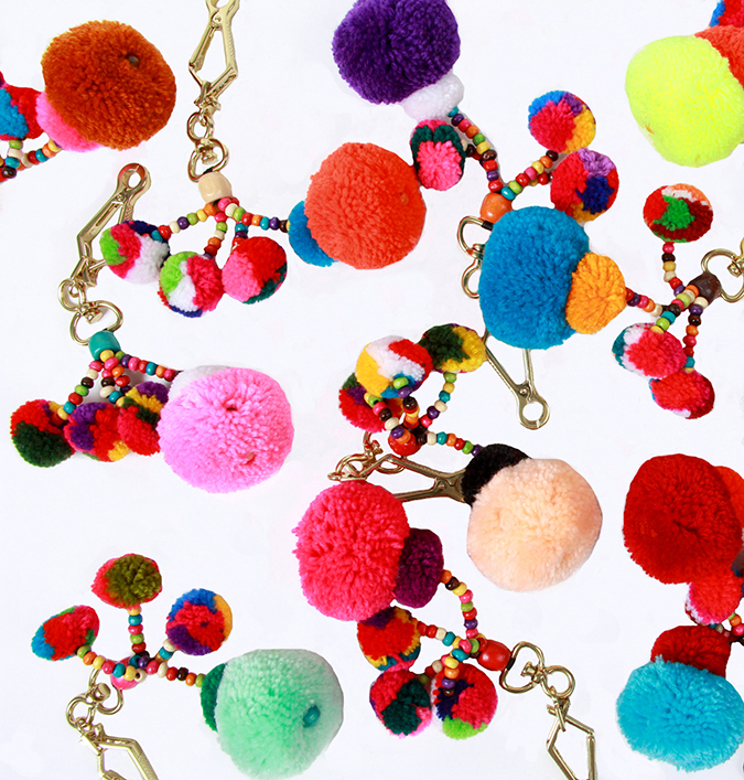 See Lauren Conrad's friday faves on the blog, including these pom pom charms that go toward a good cause...