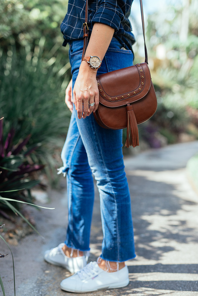 Ripped knee jeans and a crossbody bag