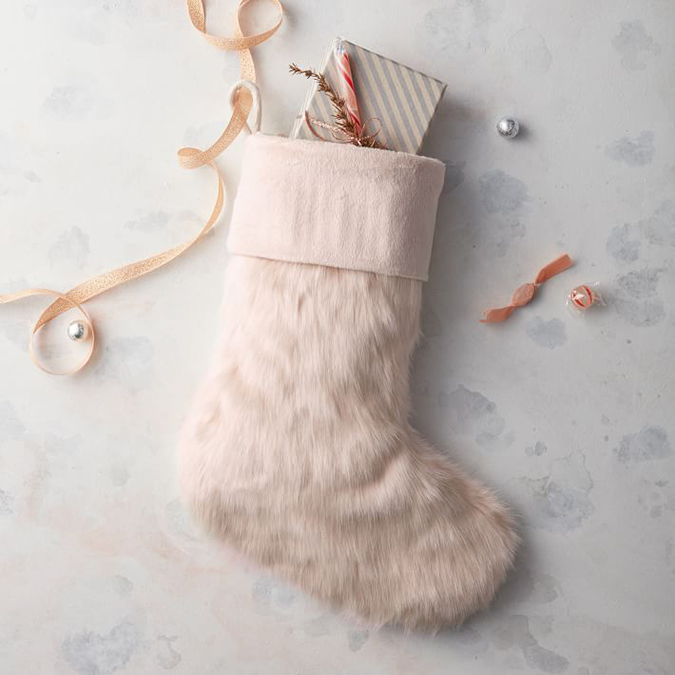 West Elm blush faux fur stocking
