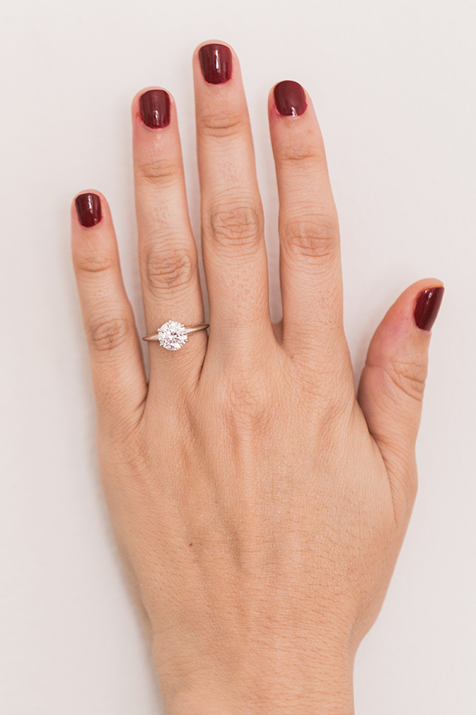 Solitaire diamond ring + holiday red mani