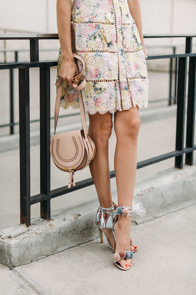 feminine floral dress and pom pom heels