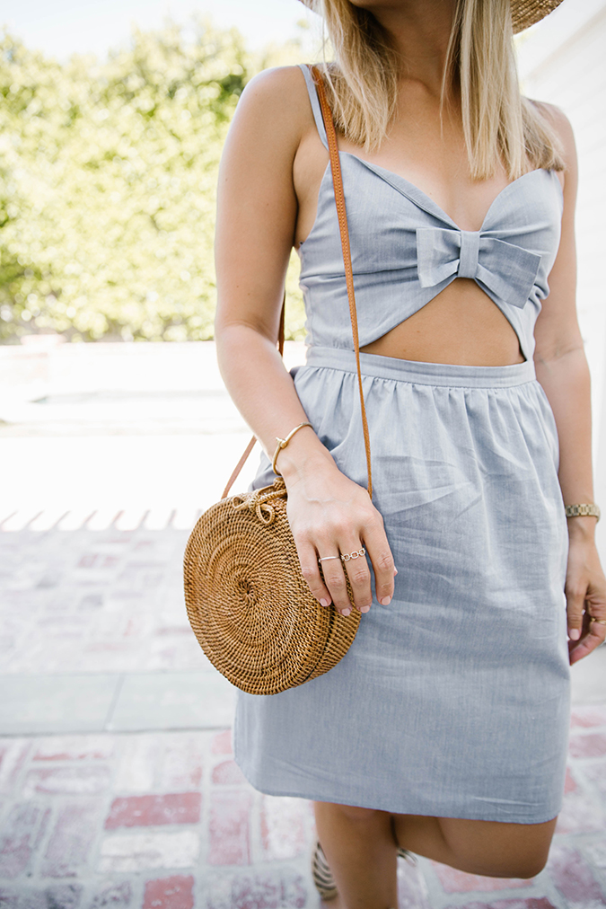 Straw circle bag and casual dress