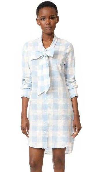 dbd4df9279af7 The beauty of this lightweight plaid dress is that it buttons down, making  it easy to nurse your little one. (The big bow will also provide some  coverage ...