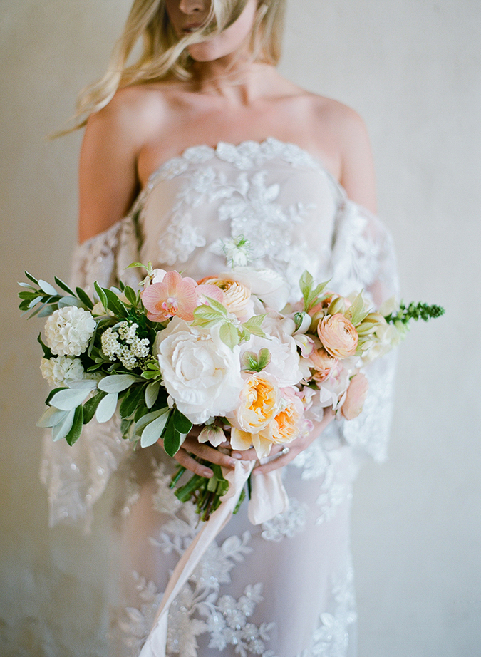 Peach bouquet and off-the-shoulder bridal gown via Jose Villa Photography
