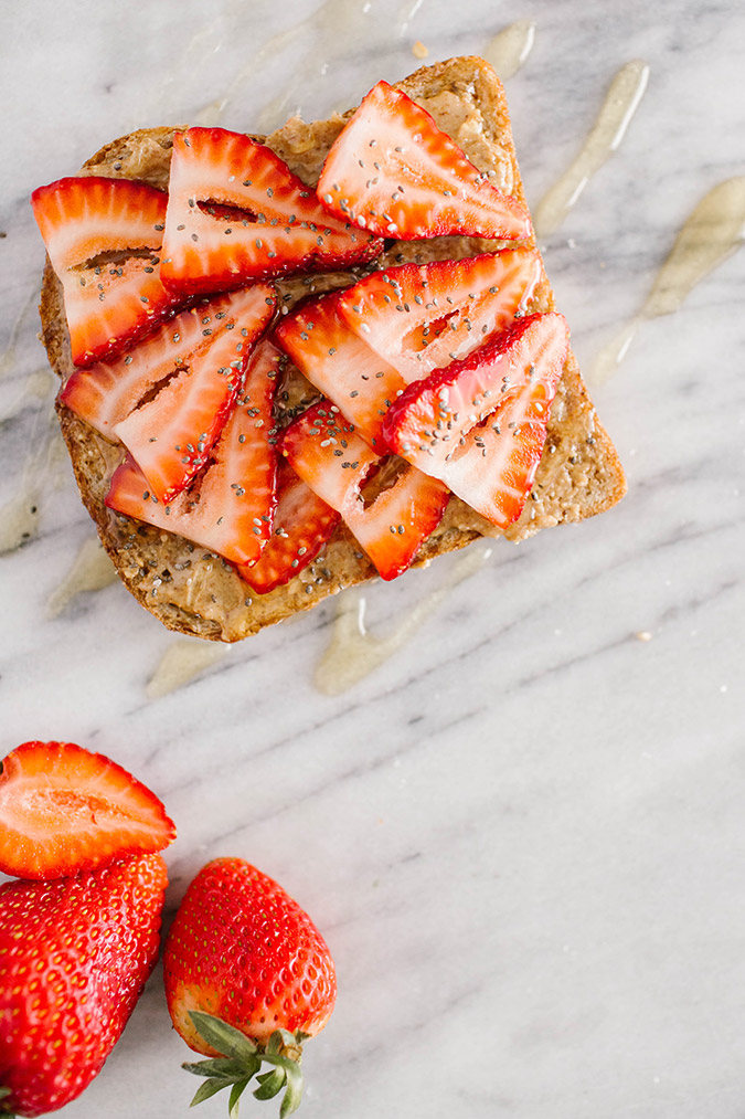 almond butter, honey, and strawberry breakfast toast