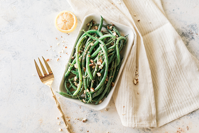 butter-blistered green beans with lemon, almonds and basil