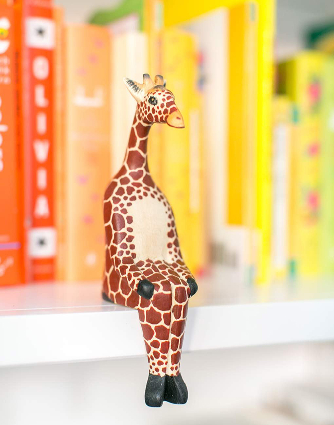 The Little Market Sitting Giraffe