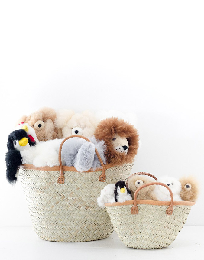 basket of stuffed animals by The Little Market