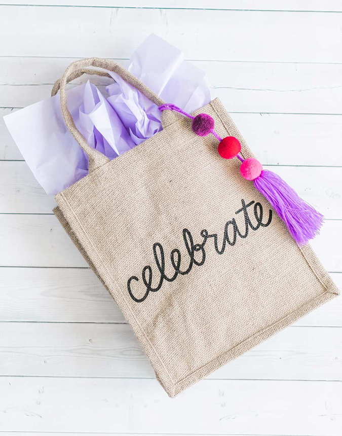 the little market celebrate reusable burlap bag