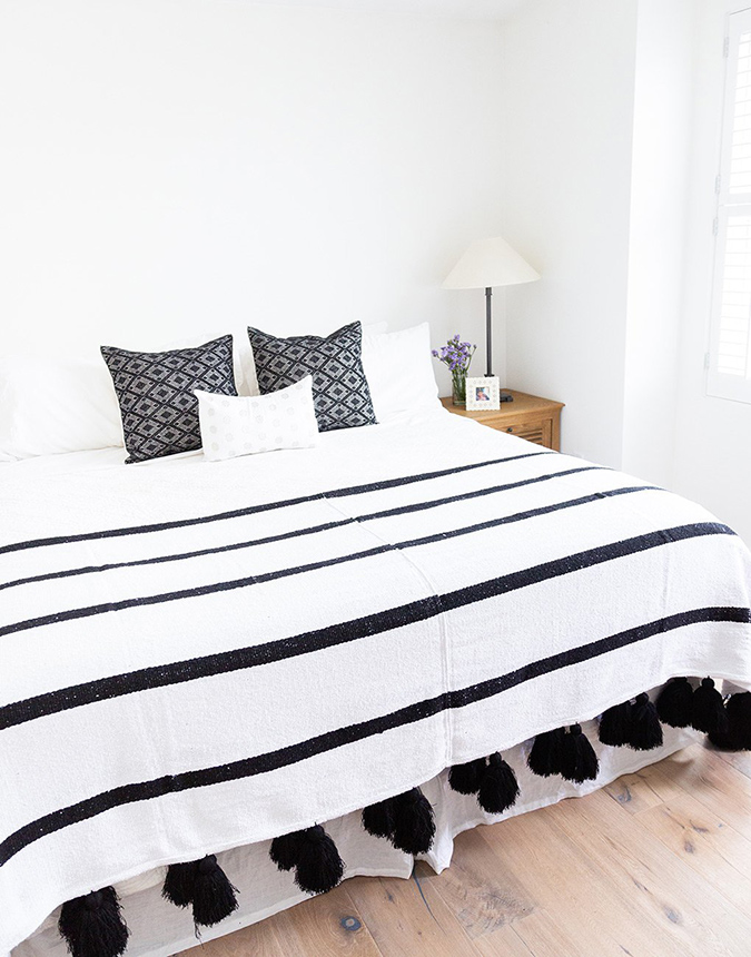 the little market white tassel blanket with black stripes