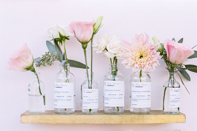 flower buds in vintage pharmacy bottles