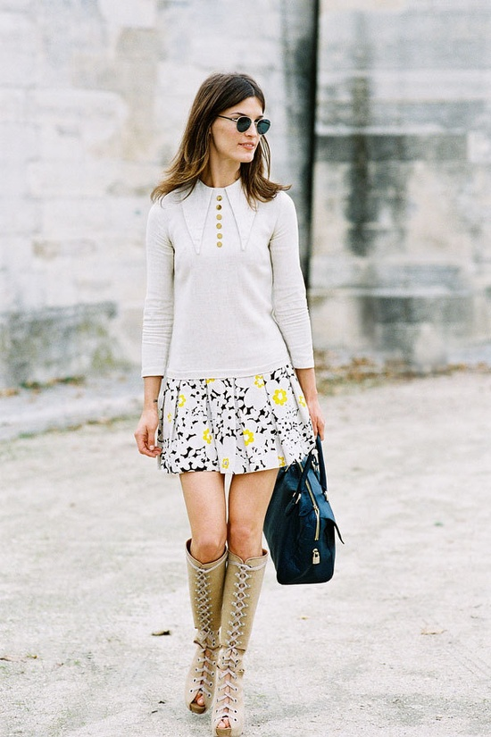 knee-high boots and a flouncy skirt